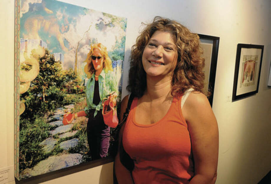 Hour photo/Matthew VinciArtist Dee Rapposelli with her digital photo print titled 'Buying the Stairway to Heaven' Tuesday night as one of the many featured artists at the FLUX art show held in the Maritime Garage Gallery. The show is running from September 29 - January 4.