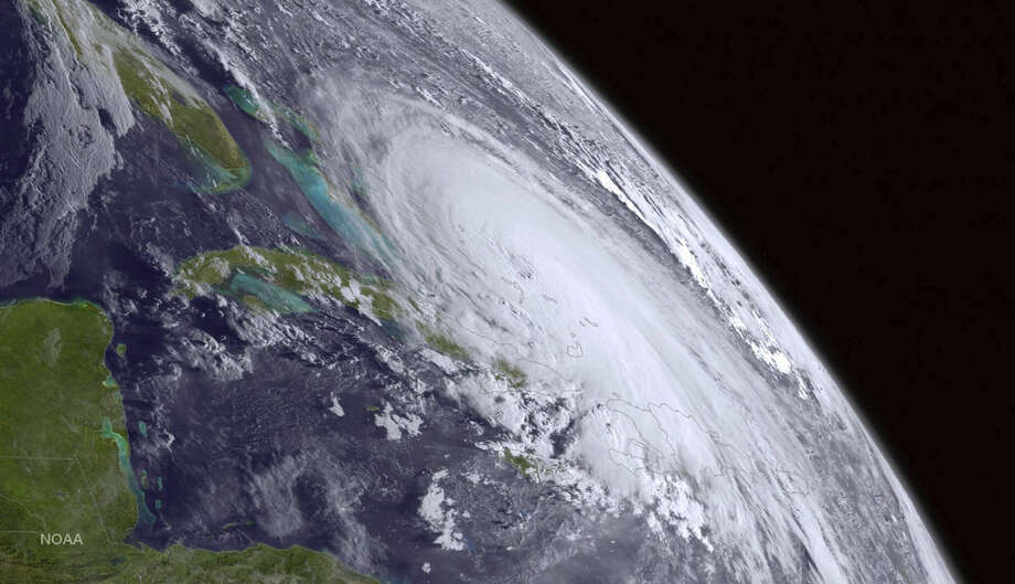 This satellite image taken Thursday, Oct. 1, 2015 at 8 a.m. EDT, and released by the National Oceanic and Atmospheric Administration (NOAA), shows Hurricane Joaquin. The powerful Category 4 hurricane pounded lightly populated islands of the eastern Bahamas on Thursday, and forecasters said it could grow more intense while following a path that would near the U.S. East Coast by the weekend. (NOAA via AP)