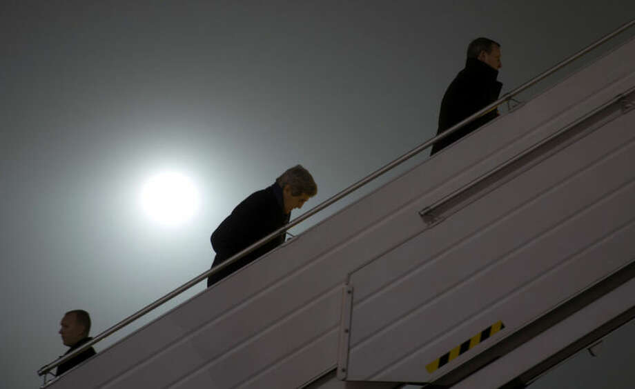 Secretary of State John Kerry, center, walks up the stairs to board his plane before his departure from Kiev, Ukraine, Tuesday, March 4, 2014. Ahead of Kerry on the stairs is Ukraine Foreign Minister Andrii Deshchytsia, who is travelling to Paris with Kerry. Kerry announced an economic package and technical assistance for Ukraine in a show of support for its new government amid escalating tensions with Russia. Kerry's visit comes as Washington and its Western allies step up pressure on Moscow to withdraw its troops from Ukraine's Crimea region or face economic sanctions and diplomatic isolation. (AP Photo/Kevin Lamarque, Pool)