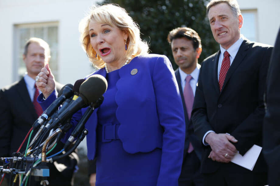 National Governors Association (NGA) Chair Oklahoma Gov. Mary Fallin, center, speaks to reporters outside the White House in Washington, Monday, Feb. 24, 2014, following a meeting between President Barack Obama and members of the NGA. From left are, Maryland Gov. Martin O'Malley, Fallin, Louisiana Gov. Bobby Jindal, and Vermont Gov. Peter Shumlin. (AP Photo/Charles Dharapak)