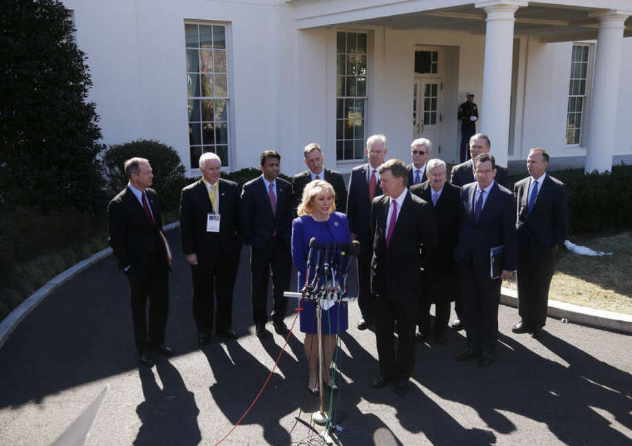 National Governors Association Chair, Oklahoma Gov. Mary Fallin, and NGA Vice Chair, Colorado Gov. John Hickenlooper, at microphones, stand with members of the National Governors Association and speak to reporters outside the White House in Washington, Monday, Feb. 24, 2014, following a meeting with President Barack Obama. From left are: Maryland Gov. Martin O'Malley, Pennsylvania Gov. Tom Corbett, Louisiana Gov. Bobby Jindal, Vermont Gov. Peter Shumlin, Missouri Gov. Jay Nixon, Mississippi Gov. Phil Bryant, Iowa Gov. Terry Branstad, Washington Gov. Jay Inslee, Connecticut Gov. Dannel Malloy, Delaware Gov. Jack Markell. (AP Photo/Charles Dharapak)