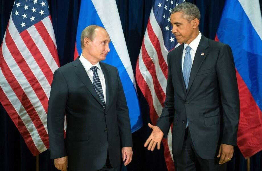 U.S. President Barack Obama, right, and Russia's President Vladimir Putin pose for members of the media before a bilateral meeting Monday, Sept. 28, 2015, at United Nations headquarters. (Sergey Guneyev/RIA-Novosti, Kremlin Pool Photo via AP)