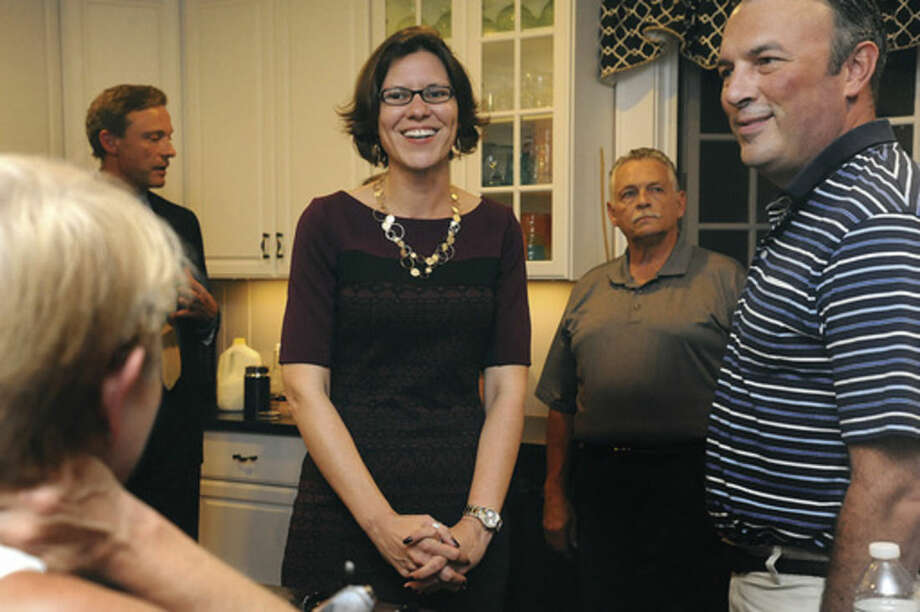 Candidate for Norwalk Mayor, Kelly Straniti at a private home in Norwalk Tuesday evening where voters met her to ask questions about her campaign. Hour photo/Matthew Vinci