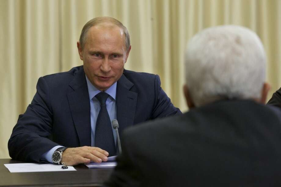 FILE - In this Sept. 22, 2015, file photo, Russian President Vladimir Putin meets with Palestinian President Mahmoud Abbas, right, in Novo-Ogaryovo residence outside Moscow. Face-to-face for the first time in nearly a year, President Barack Obama and Putin on Monday, Sept. 28, will confront rising tensions over Moscow's military engagement in Syria, as well as the stubborn crisis in Ukraine. (AP Photo/Ivan Sekretarev, File)