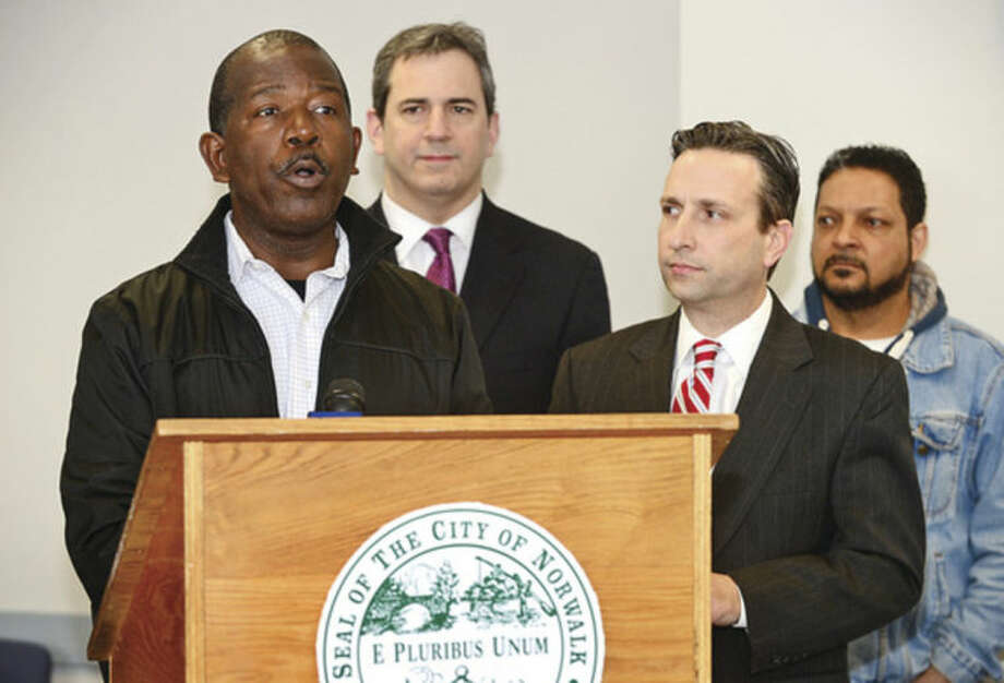 Hour photo / Erik Trautmann SECIU union representative Alberto Bernardez speaks during a press conference at City Hall Thursday after state legislators and the mayor brokered a deal for the Maritime Aquarium to hire back workers who were recently dismissed. Senator Duff is flanked by Jennifer Herring, Executive Director of the Maritime Aquarium, Norwalk Mayor Harry Rilling, State Representative Bruce Morris,, State Representative Chris Perone and former aquarium worker Nelso Acevedo.