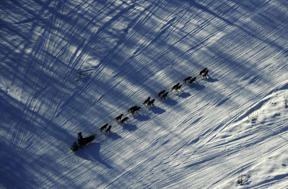 Iditarod musher Nathan Schroeder drives his dog team down the trail just after the start of the 2014 Iditarod Trail Sled Dog Race out of Willow, Alaska, Sunday, March 2, 2014. The race will take mushers nearly a thousand miles to the finish line in Nome, on Alaska's western coast. (AP Photo/Anchorage Daily News, Bob Hallinen)