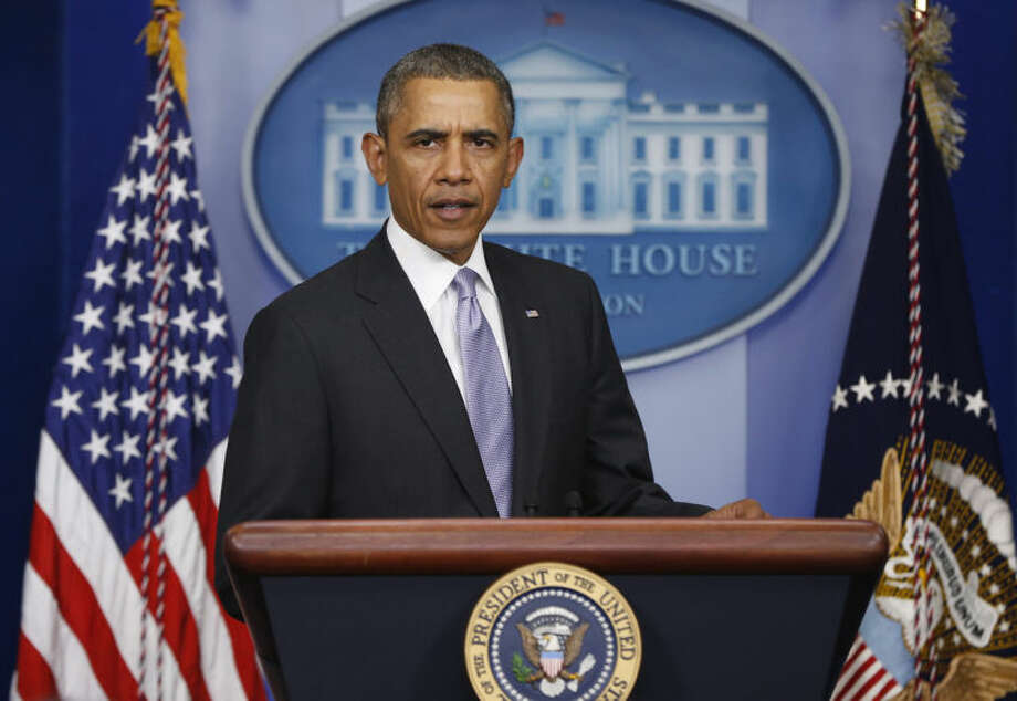 President Barack Obama arrives to speak about Ukraine in the James Brady Press Briefing Room at the White House in Washington, Friday, Feb. 28, 2014. Obama's statement comes as his administration is expressing growing concern over Russian intentions in Ukraine. Secretary of State John Kerry delivered a blunt warning Friday to Moscow against military moves in the country's southern Crimea region that could further inflame tensions. (AP Photo/Charles Dharapak)