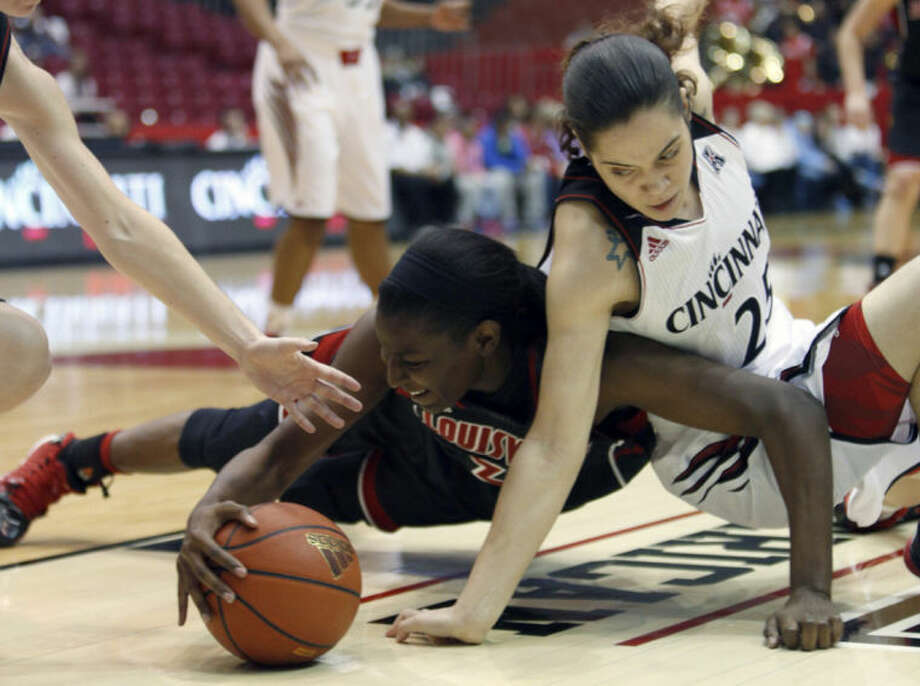 Louisville forward Asia Taylor (31) goes for the ball against Cincinnati guard Chelsea Jamison (25) during the first half of an NCAA college basketball game, Saturday, March 1, 2014, in Cincinnati. (AP Photo/David Kohl)