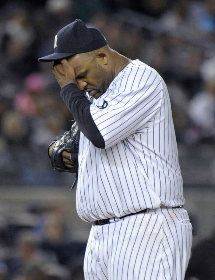 FILE - In this Sept. 25, 2015, file photo, New York Yankees pitcher CC Sabathia reacts during the seventh inning of a baseball game against the Chicago White Sox at Yankee Stadium in New York. Sabathia is checking into an alcohol rehabilitation center and will miss the postseason. The team released a statement from the pitcher Monday, Oct. 5, 2015, a day before New York plays Houston in the AL wild-card game. (AP Photo/Bill Kostroun, File)