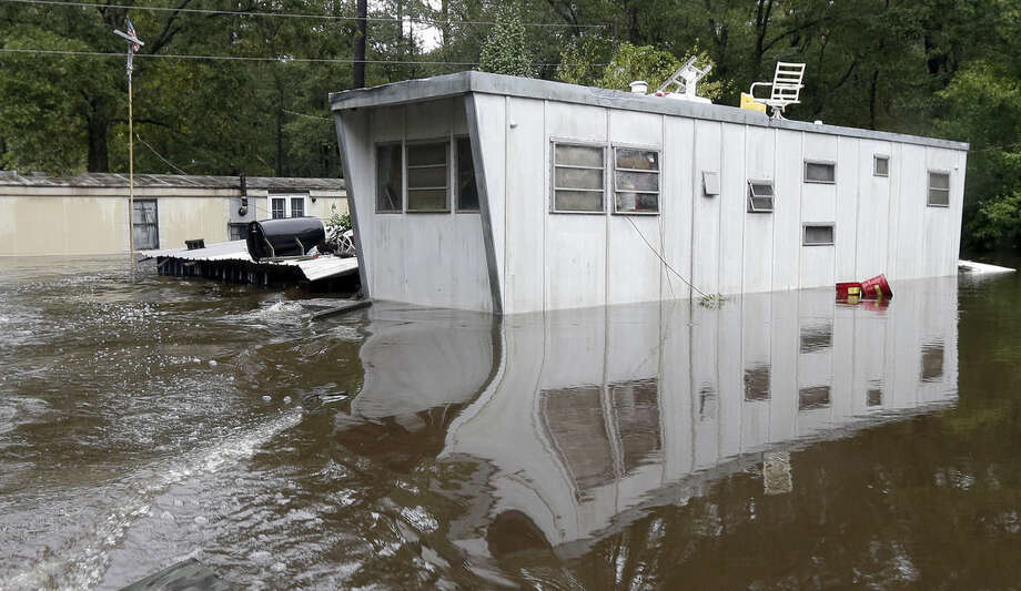 Floodwaters surround mobile homes following flooding in Florence, S.C., Monday, Oct. 5, 2015. Flooding continues throughout the state following record rainfall amounts over the last several days. (AP Photo/Gerry Broome)