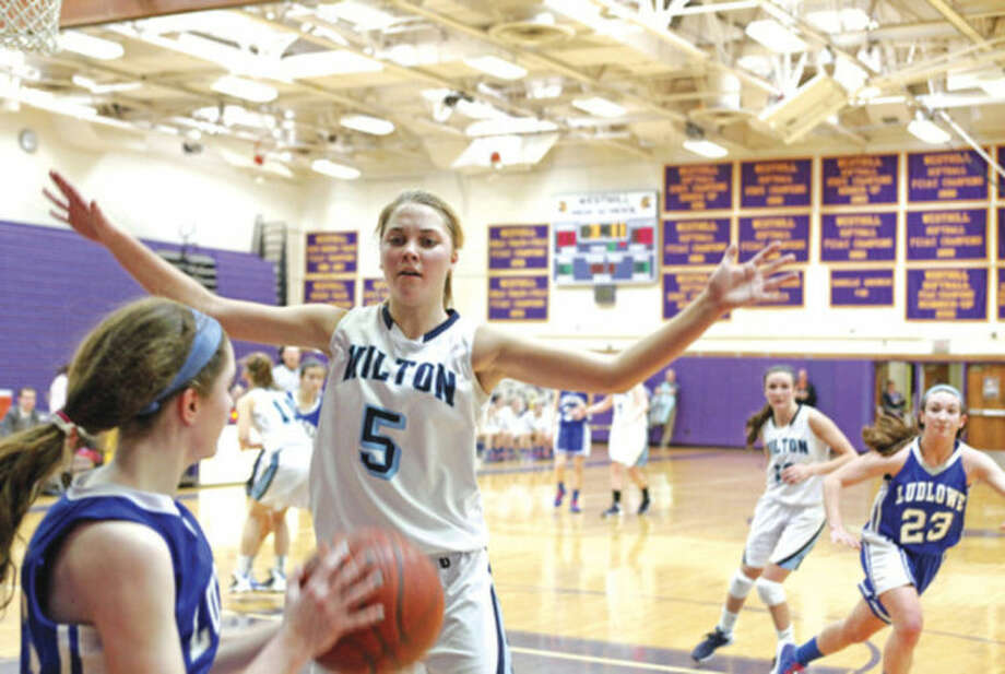 Hour photo/Danielle CallowayWilton's Karen Brosko, center, guards the inbounds pass during Saturday's FCIAC quarterfinal game against Fairfield Ludlowe at the Westhill High gym. Wilton advanced to the semis with a 48-29 victory.