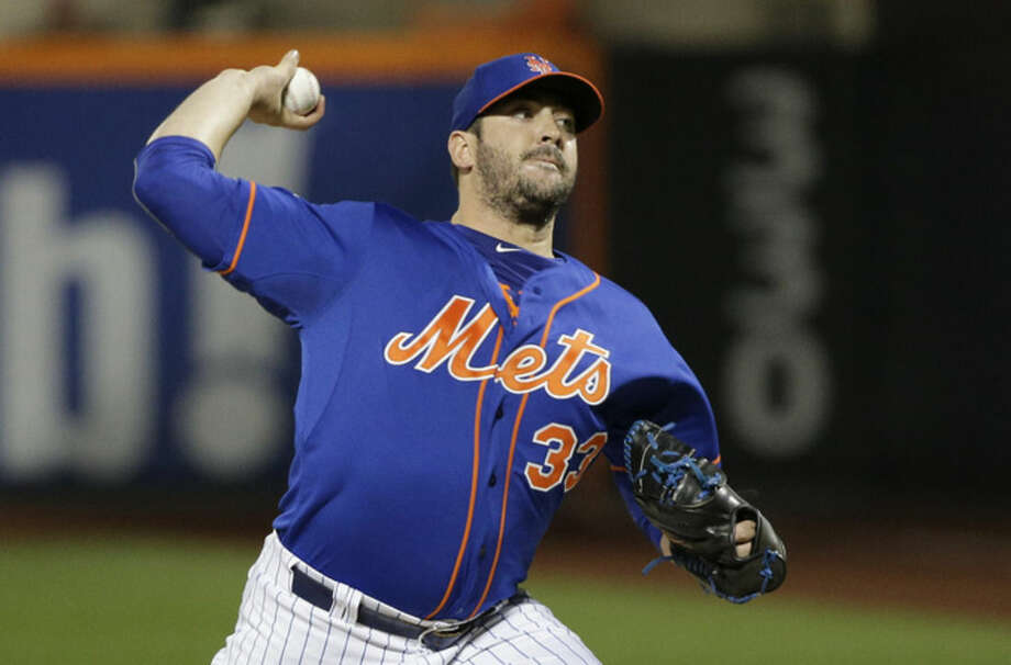 New York Mets pitcher Matt Harvey (33) delivers against the Los Angeles Dodgers during the first inning of baseball's Game 3 of the National League Division Series, Monday, Oct. 12, 2015, in New York. (AP Photo/Julie Jacobson)