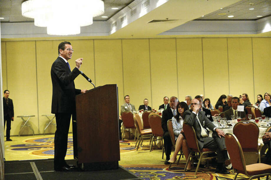 Hour photo / Erik Trautmann CT Governor Dannel Malloy addresses the Stamford Chamber of Commerce during their lucneon at the Stamford Marriot Thursday.