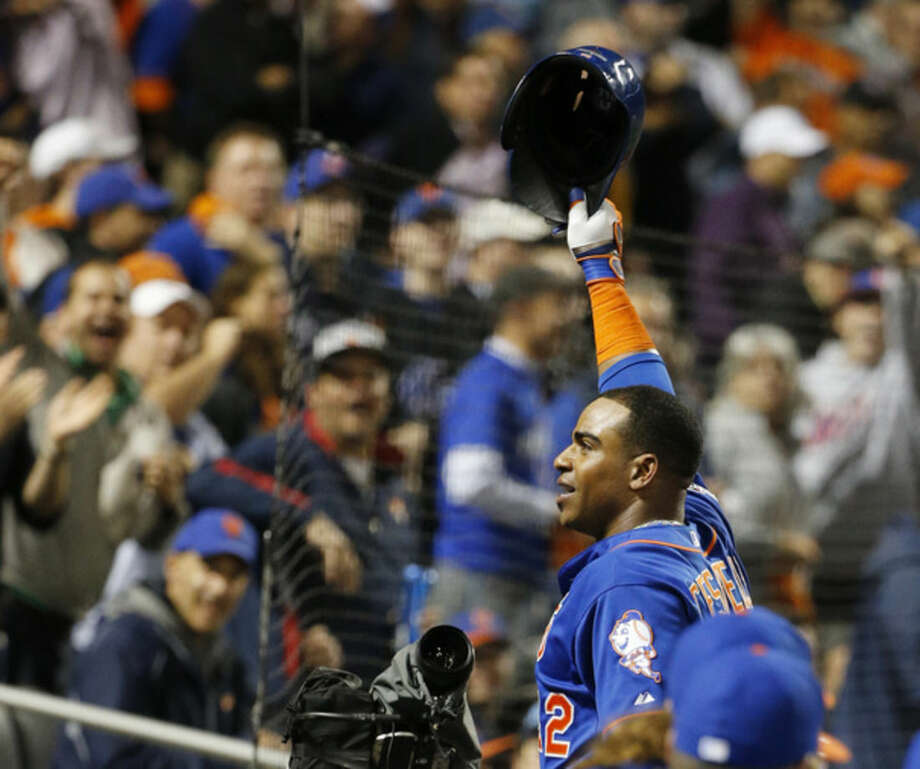 New York Mets' Yoenis Cespedes takes a curtain call after hitting a three-run home run off Los Angeles Dodgers starting pitcher Brett Anderson during the fourth inning of baseball's Game 3 of the National League Division Series Monday, Oct. 12, 2015, in New York. (AP Photo/Kathy Willens)