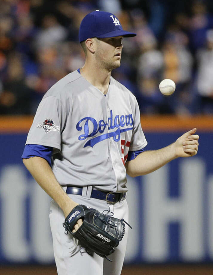 Los Angeles Dodgers pitcher Alex Wood (57) reacts after giving up a three-run home run to New York Mets' Yoenis Cespedes during the fourth inning of baseball's Game 3 of the National League Division Series, Monday, Oct. 12, 2015, in New York. (AP Photo/Julie Jacobson)