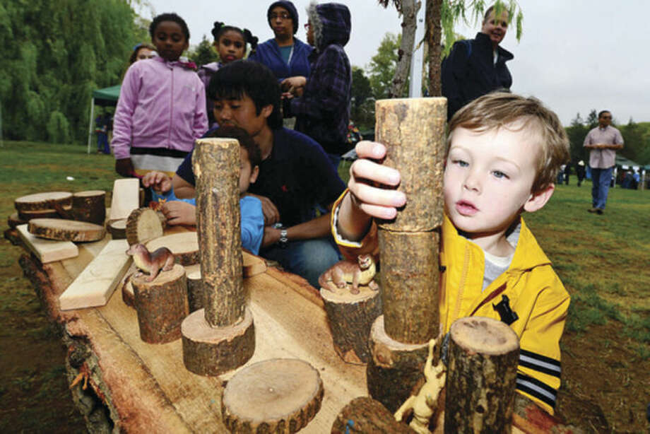 Hour file photo / Erik TrautmannBrian O'Gorman builds with logs from the Westport Tree Alliance at The 7th annual Norwalk Wilton Tree Festival at Cranbury Park in 2013.