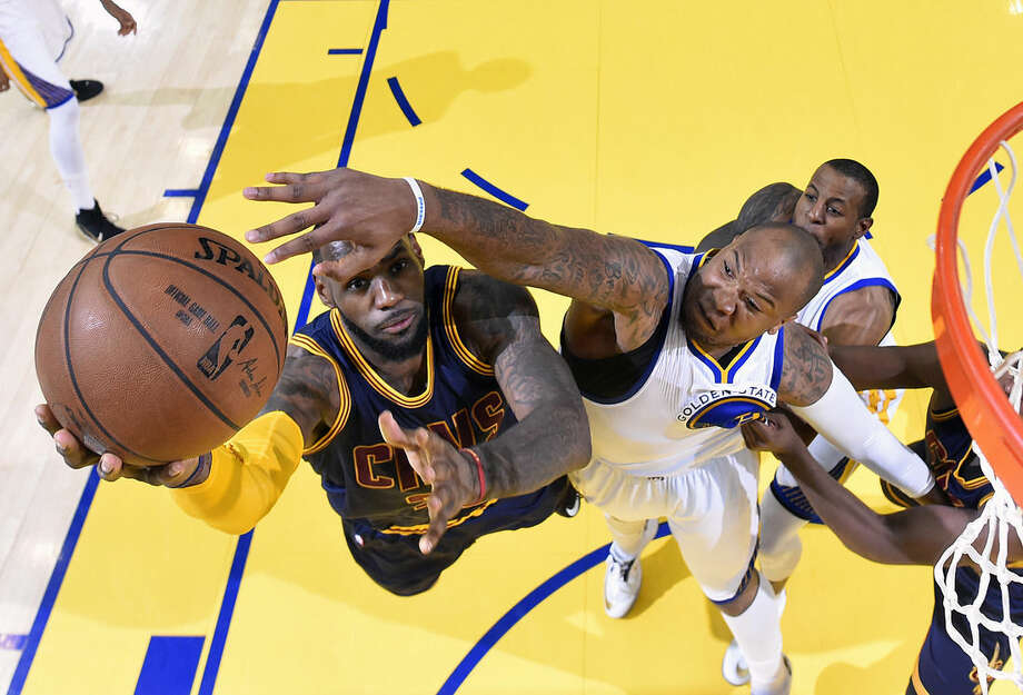 FILE - In this June 7, 2015, file photo, Cleveland Cavaliers forward LeBron James, left, shoots against Golden State Warriors forward Marreese Speights during the first half of Game 2 of basketball's NBA Finals in Oakland, Calif. There are several options for sports fans without cable to watch live games. (Kyle Terada/USA Today via AP, Pool, File)