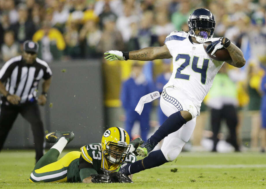 FILE - In this Sept. 20, 2015 file photo, Seattle Seahawks' Marshawn Lynch is tripped up by Green Bay Packers' Nick Perry (53) during the first half of an NFL football game, in Green Bay, Wis. There are several options for sports fans without cable to watch live games. (AP Photo/Jeffrey Phelps, File)