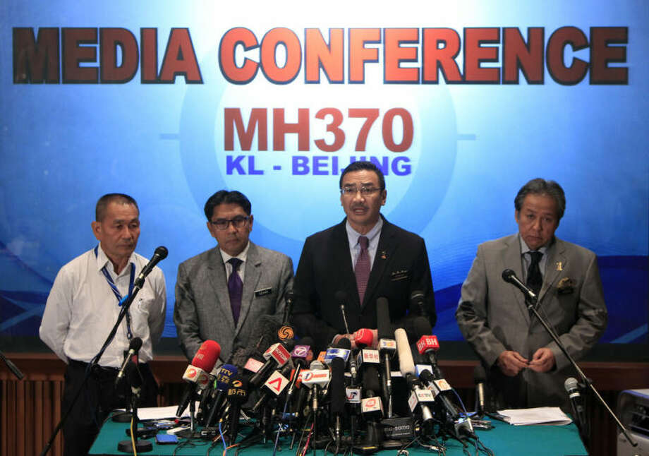 Malaysian acting Transport Minister Hishammuddin Hussein, second from right, speaks as Malaysian Foreign Minister Anifah Aman, right, Malaysia's Department of Civil Aviation director general Azharuddin Abdul Rahman, second left, and Malaysia Airlines Group Chief Executive Ahmad Jauhari Yahyain listen during a press conference at a hotel in Sepang, Malaysia, Tuesday, March 18, 2014. Checks into the background of all the Chinese nationals on board the missing Malaysian jetliner have uncovered no links to terrorism, the Chinese ambassador in Kuala Lumpur said Tuesday. T (AP Photo/Lai Seng Sin)