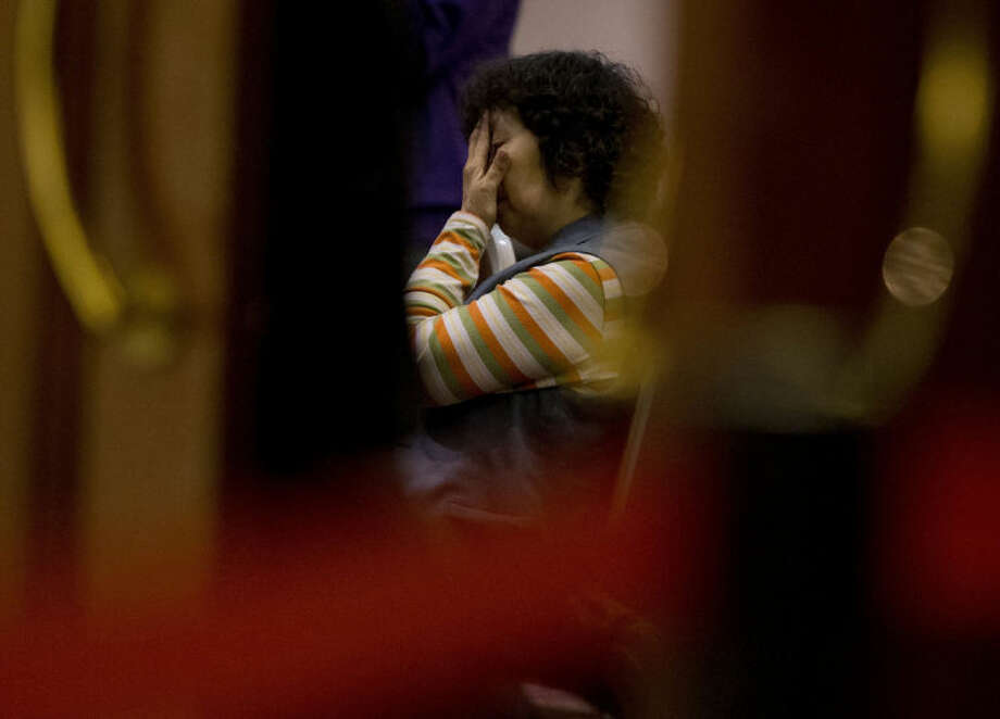 AP Photo/Andy WongA relative of Chinese passengers aboard the missing Malaysia Airlines Flight MH370 waits for a news briefing by the Airlines' officials at a hotel ballroom in Beijing, China, Tuesday, March 18.