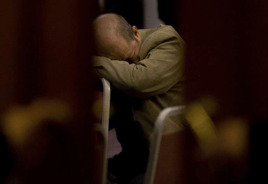 A relative of Chinese passengers aboard the missing Malaysia Airlines Flight MH370 rests on a chair as he waits for a news briefing by the Airlines' officials at a hotel ballroom in Beijing, China, Tuesday, March 18, 2014. Families of the passengers aboard the missing plane decided to organize a hunger strike to express their anger and disappointment at the handling of the situation by authorities. They decided on the action after a daily morning meeting with two officials from Malaysia Airlines. The plane has been missing since March 8, and contradictory information plus the fact there has been no sign of the plane has left family members frustrated. (AP Photo/Andy Wong)