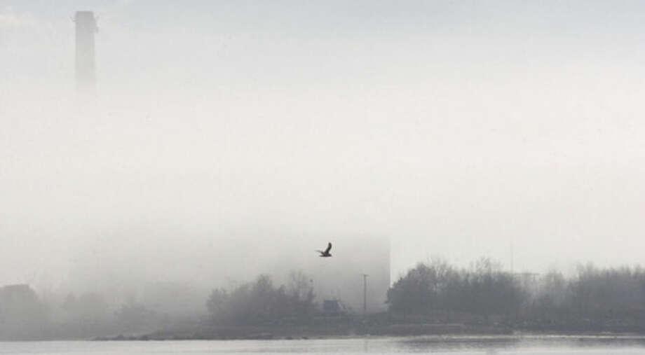 Hour Photo/ Alex von Kleydorff. Fog surrounds the Manresa Power Plant in Norwalk on a warm first day of spring