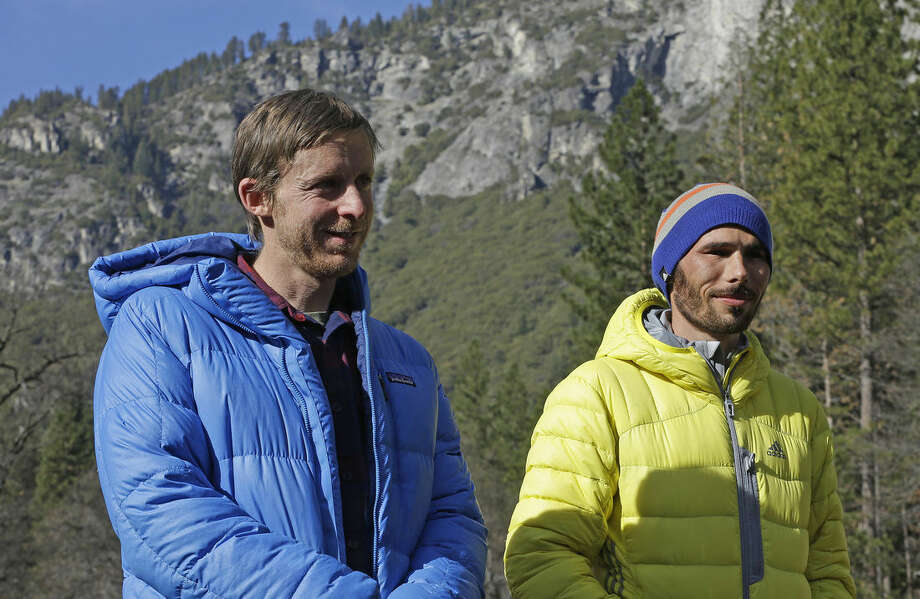 Tommy Caldwell, left, and Kevin Jorgeson wait to speak during a news conference Thursday, Jan. 15, 2015, in El Capitan meadow in Yosemite National Park, Calif. The two climbers became the first in the world to use only their hands and feet to scale El Capitan, a sheer granite face in California's Yosemite National Park. (AP Photo/Ben Margot)