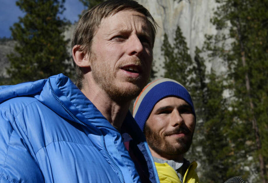 Climbers Tommy Caldwell, left, and Kevin Jorgeson, right, speak during a press conference in Yosemite Valley near the base of El Capitan Thursday morning, Jan. 15, 2015 in Yosemite National Park, Calif. The two Americans became the first to free-climb El Capitan's Dawn Wall. They used ropes and safety harnesses in case of a fall but relied only on their hands, feet and strength to reach the 3,000-foot summit the day before. The trek began Dec. 27. (AP Photo/The Fresno Bee, Eric Paul Zamora)