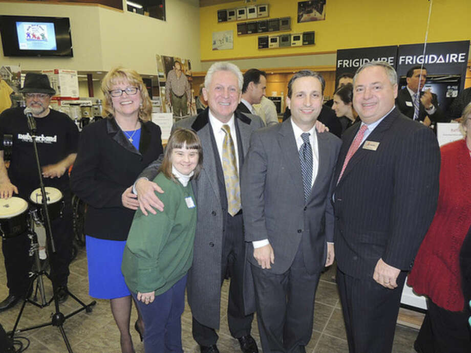 Contributed photoSTAR Executive Director Katie Banzhaf is pictured with state Senator Bob Duff, Mayor Harry Rilling , STAR client Becky Flynn and Tony Aitoro at a benefit held for STAR last week at Aitoro's.
