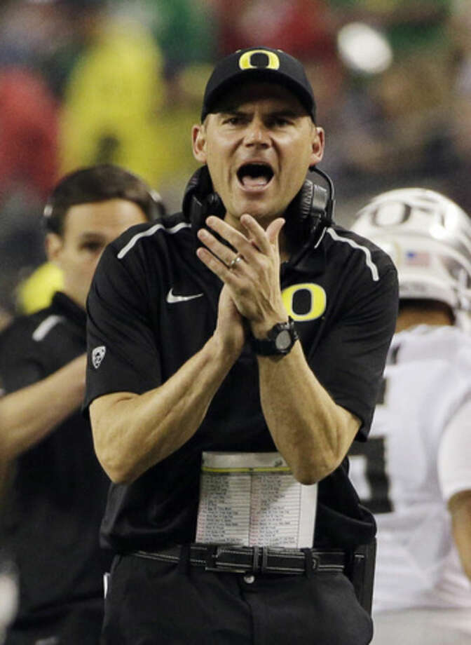 Oregon head coach Mark Helfrich reacts during the first half of the NCAA college football playoff championship game against Ohio State Monday, Jan. 12, 2015, in Arlington, Texas. (AP Photo/David J. Phillip)