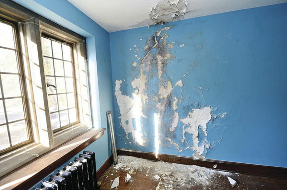 Hour photo / Erik Trautmann The Gallaher Mansion's slate roof has been leaking for some time damaging walls and ceilings on the second floor of the historic home. Tuesday was the deadline for firms to submit bids to install new slate roof on historic Gallaher Mansion at Cranbury Park.