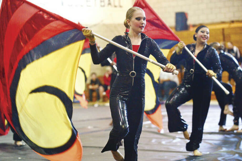 Hour photos / Erik TrautmannAbove, Katherine Fallon and the Norwalk High School Scholastic AA Winter Guard compete at the Music Arts Conference 2014 Winter Guard and Percussion Home Show at Norwalk High School Saturday. Below, Annabella Nielson participates in the competition.