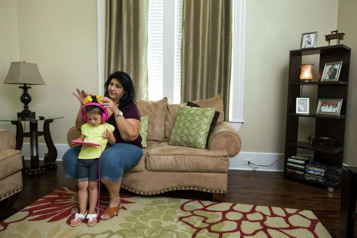 Adeline Gonzales sits with her granddaughter Ah'Lina Jones in the living room at her sister's house on Saturday, May 28, 2016, in Houston. Gonzales is a single mother struggling to locate affordable housing for her family. ( Brett Coomer / Houston Chronicle )