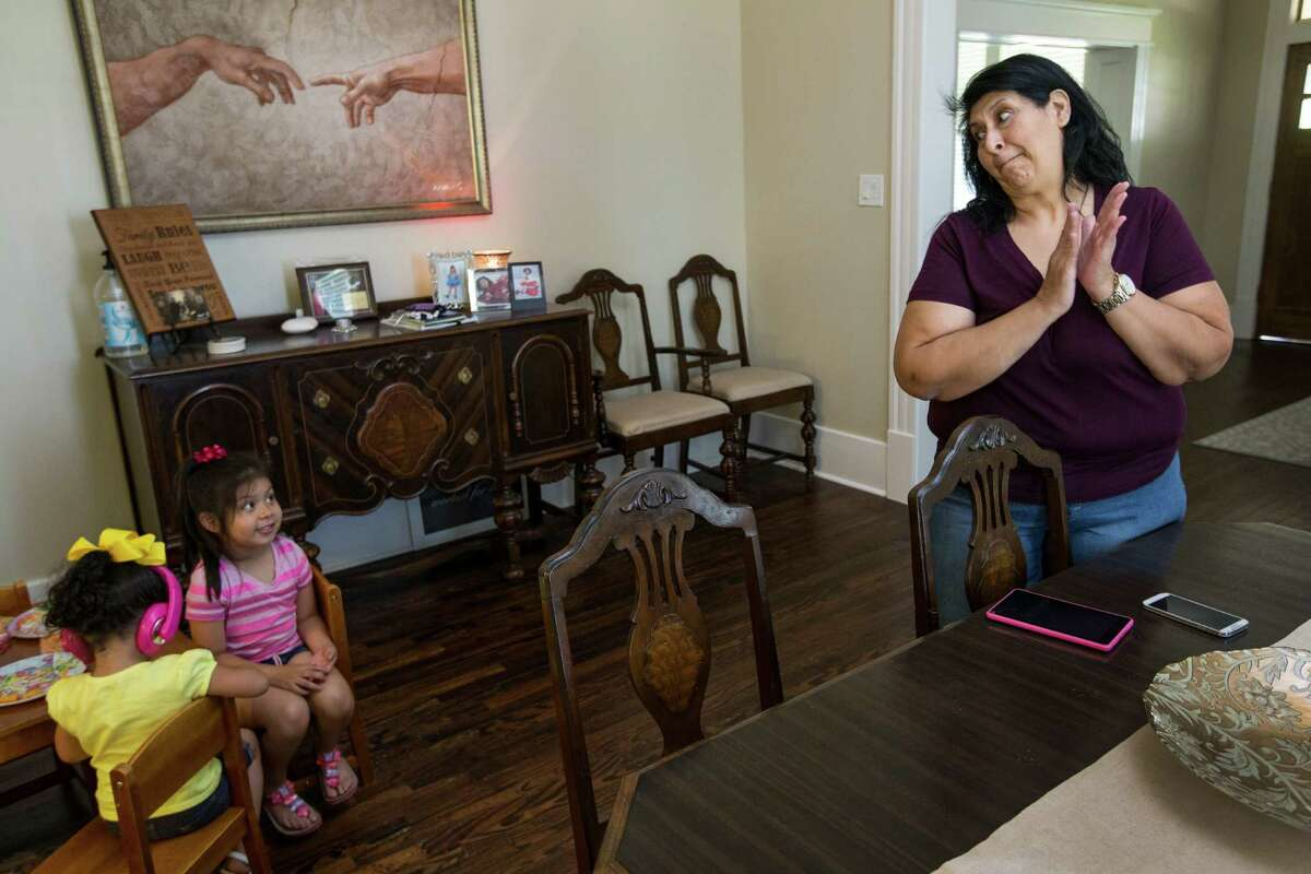 Adeline Gonzales interacts with her granddaughter Ah'Lina Jones, far left, and neice, Jackie Revilla, in the living room at her sister's house on Saturday, May 28, 2016, in Houston. Gonzales is a single mother struggling to locate affordable housing for her family. ( Brett Coomer / Houston Chronicle )