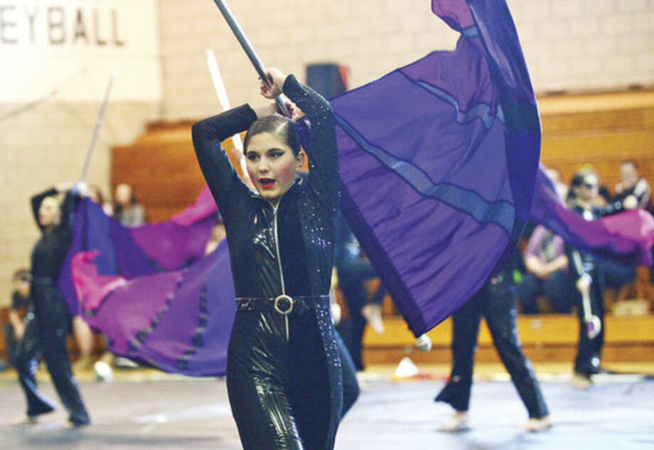 Hour photo / Erik Trautmann Annabella Nielson and the Norwalk High School Scholastic AA Winter Guard compete in the Music Arts Conference (MAC) 2014 Winter Guard and Percussion Home Show at Norwalk High School Saturday.