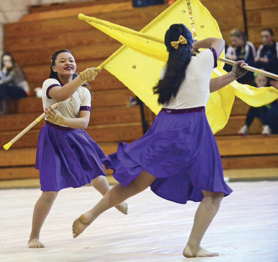 Hour photo / Erik Trautmann Alexia Pote and the Brien McMahon High School Scholastic Open Winter Guard compete at the Music Arts Conference (MAC) 2014 Winter Guard and Percussion Home Show at Norwalk High School Saturday.