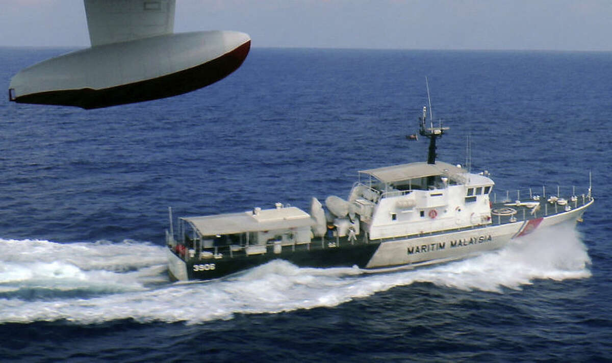 In this photo released by Malaysian Maritime Enforcement Agency, a patrol vessel of Malaysian Maritime Enforcement Agency searches for the missing Malaysia Airlines plane off Tok Bali Beach in Kelantan, Malaysia, Sunday, March 9, 2014. Military radar indicates that the missing Boeing 777 jet may have turned back, Malaysia?'s air force chief said Sunday as scores of ships and aircraft from across Asia resumed a hunt for the plane and its 239 passengers. (AP Photo/Malaysian Maritime Enforcement Agency)