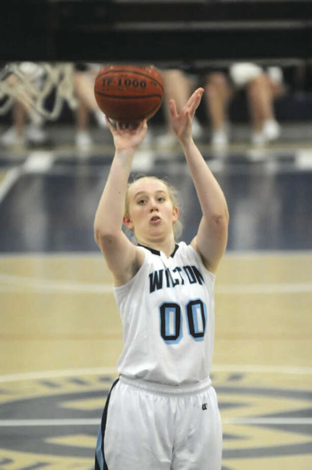 Hour photo/John NashErica Meyer of Wilton has been through an emotional year and now her Warriors are headed to the quarterfinals.