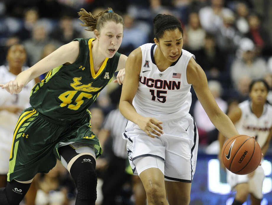 Connecticut's Gabby Williams, right, steals the ball from South Florida's Katelyn Weber, left, during the first half of an NCAA college basketball game, Sunday, Jan. 18, 2015, in Storrs, Conn. (AP Photo/Jessica Hill)
