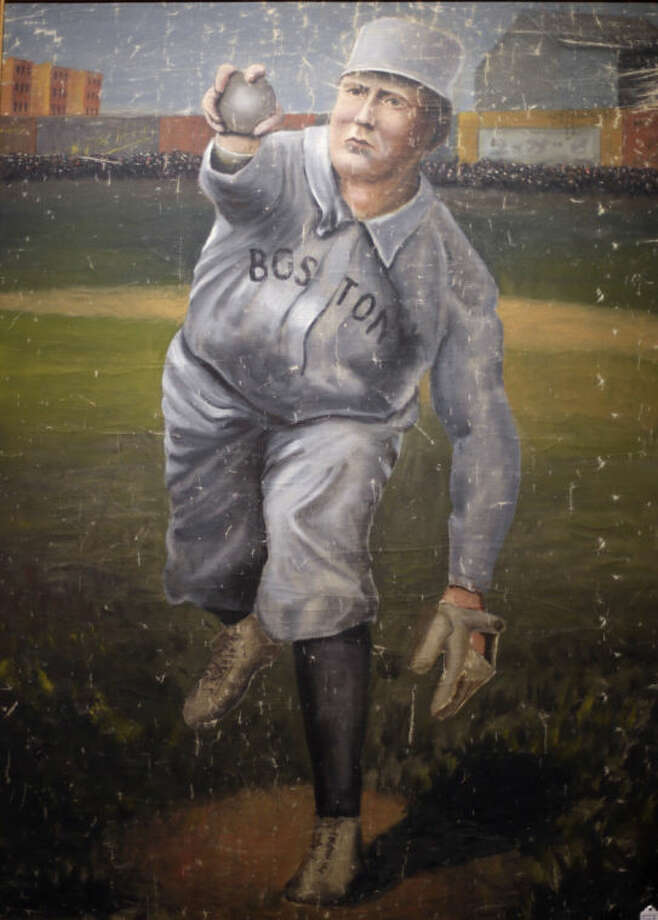 In this photo made Tuesday, March 11, 2014, a 1910 painting of Cy Young in a Boston Red Sox uniform is on display at the Saco River Auction House in Biddeford, Maine. The auction house is getting a reputation for selling some of the nation's oldest baseball memorabilia. (AP Photo/Robert F. Bukaty)