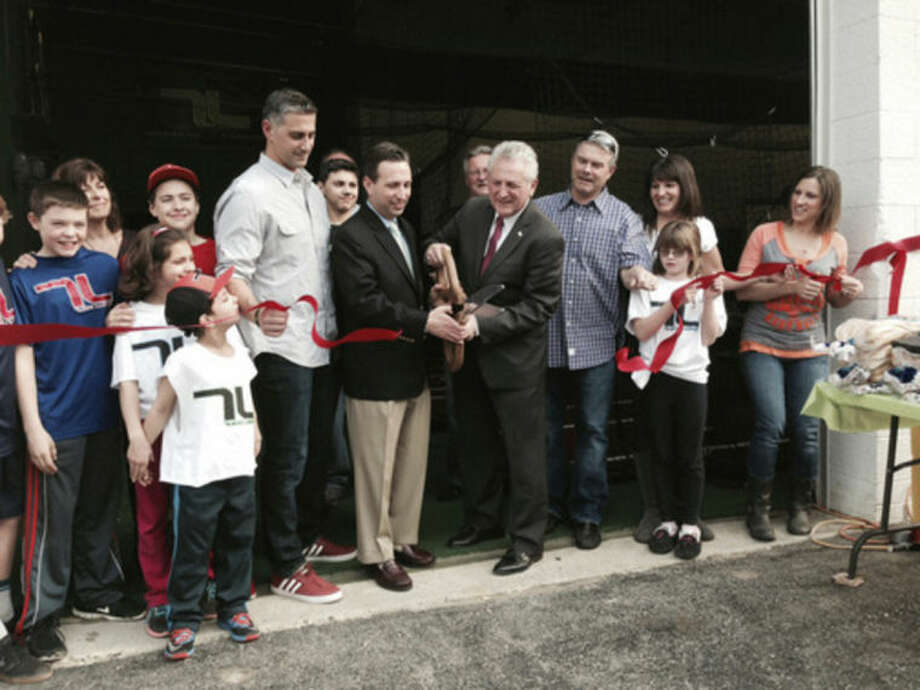 Contributed photoOwner Pete Tucci holds the ribbon while state Sen. Bob Duff and Norwalk Mayor Harry Rilling cut the ribbon at the grand opening for Tucci Lumber's new location on Wilson Avenue in Norwalk on Friday, April 11.