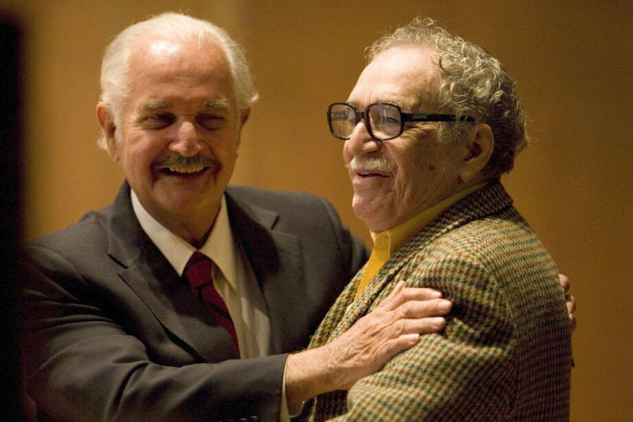 FILE - In this Nov. 18, 2008 file photo, Mexican writer Carlos Fuentes, left, embraces Colombian author Gabriel Garcia Marquez during a round table discussion on Fuentes' work at the UNAM national university in Mexico City. Marquez died Thursday April 17, 2014 at his home in Mexico City. (AP Photo/Dario Lopez-Mills, File)