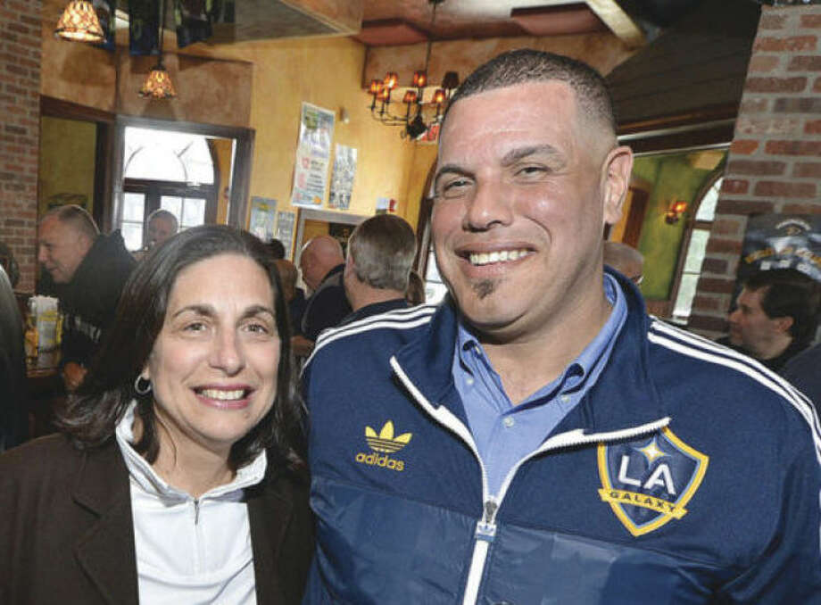 Hour photo / Alex von KleydorffNorwalk Police Sgts. Lisa and Carlos Cotto enjoy some time with friends and collegues at O'Neills Pub & Restaurant Thursday. The couple are retiring from the Norwalk Police Department after nearly 60 combined years of service.