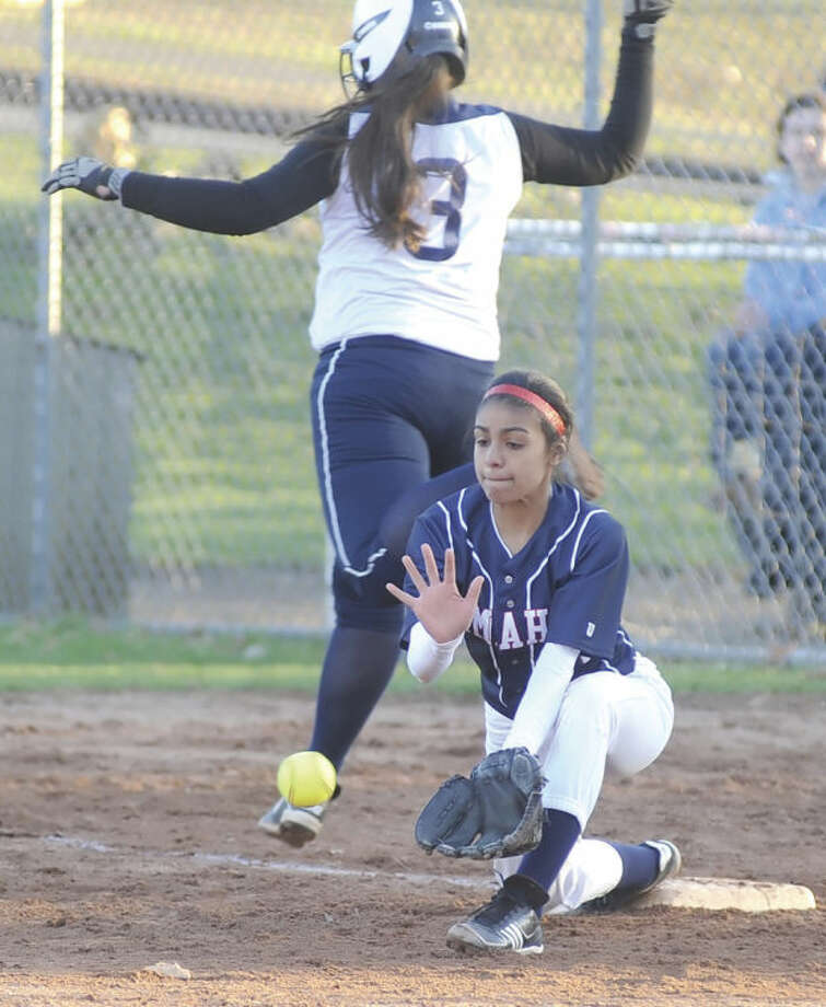 Hour photo/John NashAlayne Martinez stretches off first base during McMahon's Wednesday afternoon game against Staples.