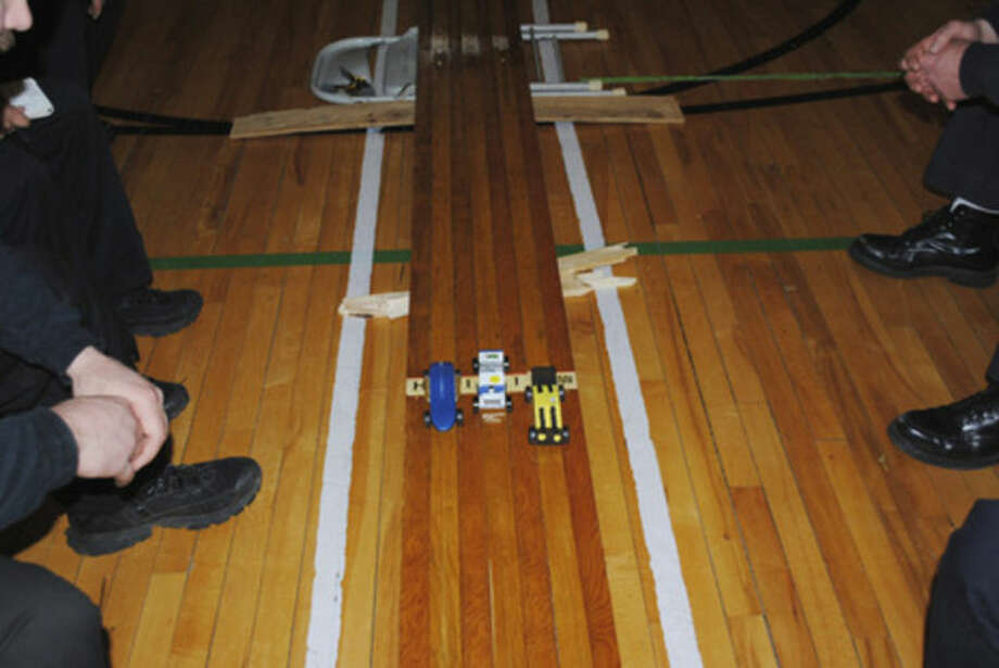 Contributed photoNorwalk police and fire personnel helped out with Cub Scout Troop 61's recently held Pinewood Derby held at Brookside School.