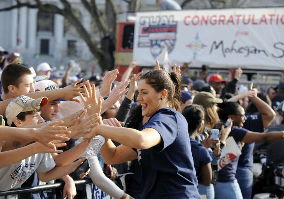 Connecticut's Stefanie Dolson interacts with with fans after a parade in Hartford, Conn., on Sunday, April 13, 2014, celebrating her team's recent NCAA national basketball championship. (AP Photo/Fred Beckham)