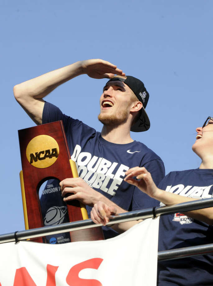 Connecticut's Niels Giffey watches the fans during a parade in Hartford, Conn., on Sunday, April 13, 2014, celebrating his team's recent NCAA national basketball championship. (AP Photo/Fred Beckham)