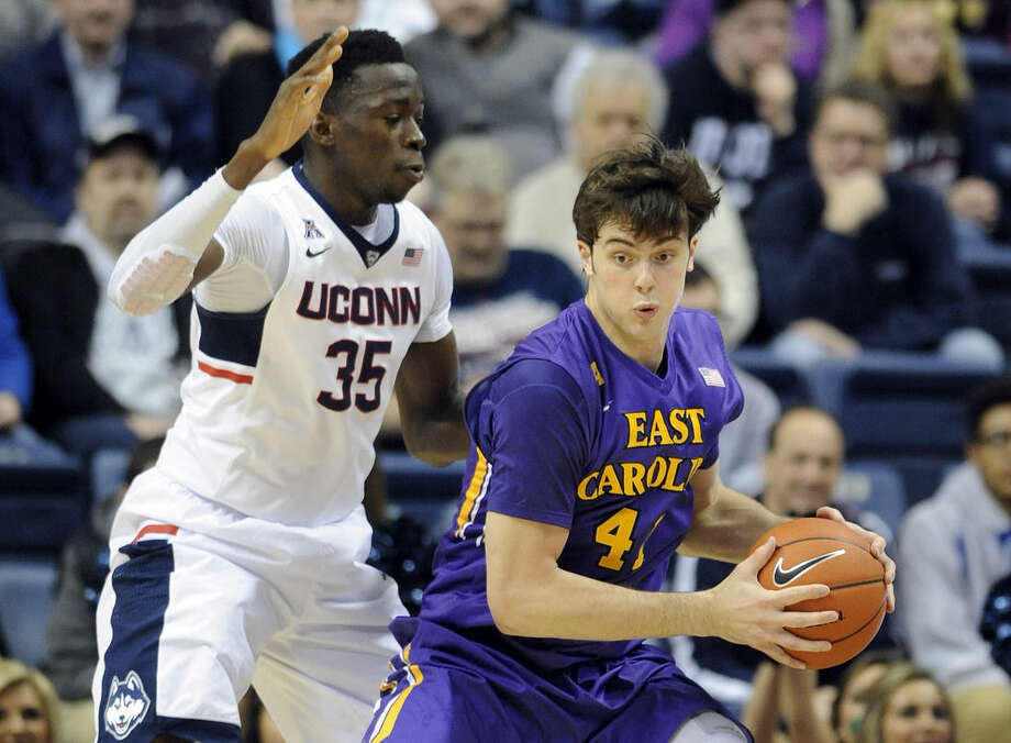 Connecticut's Amida Brimah (35) guards East Carolina's Marshall Guilmette (41) during the first half of an NCAA college basketball game in Storrs, Conn., on Wednesday, Feb. 4, 2015. (AP Photo/Fred Beckham)