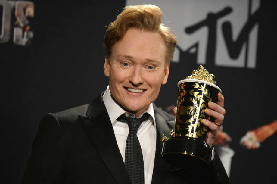 Conan O'Brien poses in the press room at the MTV Movie Awards on Sunday, April 13, 2014, at Nokia Theatre in Los Angeles. (Photo by Jordan Strauss/Invision/AP)