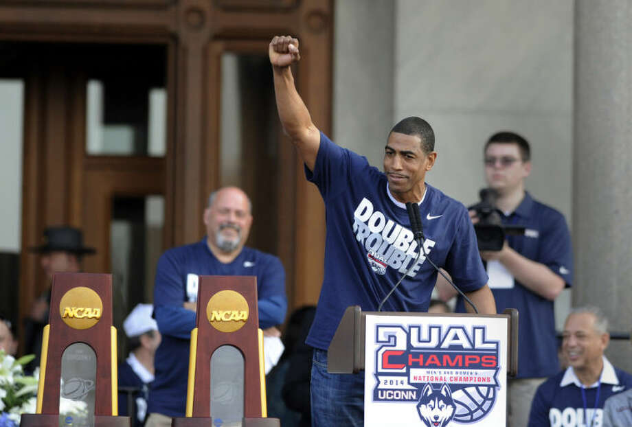 Connecticut men's basketball coach Kevin Ollie gestures during a celebration of UConn's championships in the NCAA men's and women's tournaments, at a rally at the State Capitol in Hartford, Conn., on Sunday, April 13, 2014. (AP Photo/Fred Beckham)